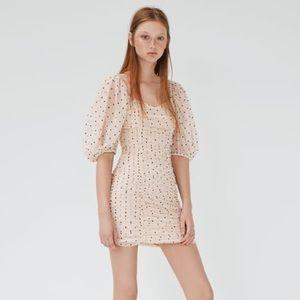 Polka dot draped tulle dress